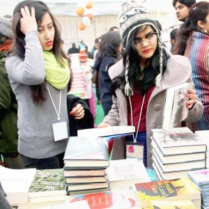 Visitors-browsing-through-books-during-the-ongoing-Jaipur-Literature-Festival-in-Jaipur-on-January-19-2014-